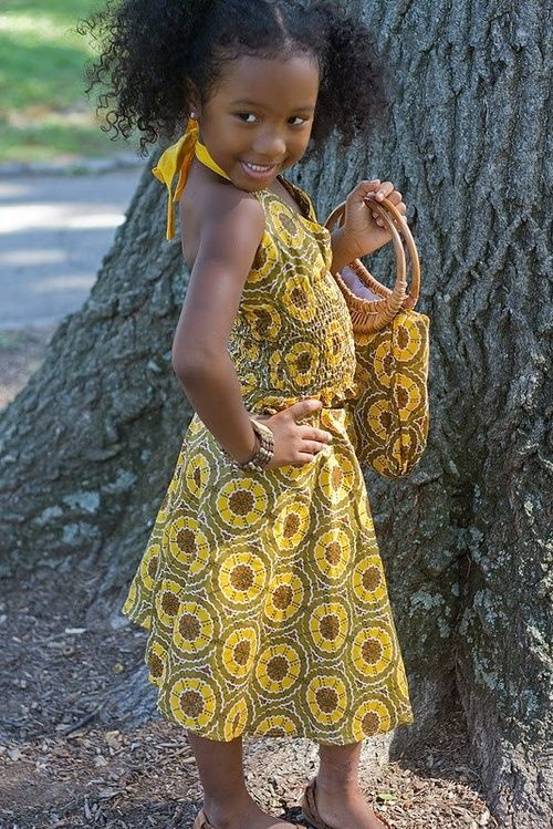 Looking lovely baby girl in your sundress with matching bag. Momma got your dressed sharp...