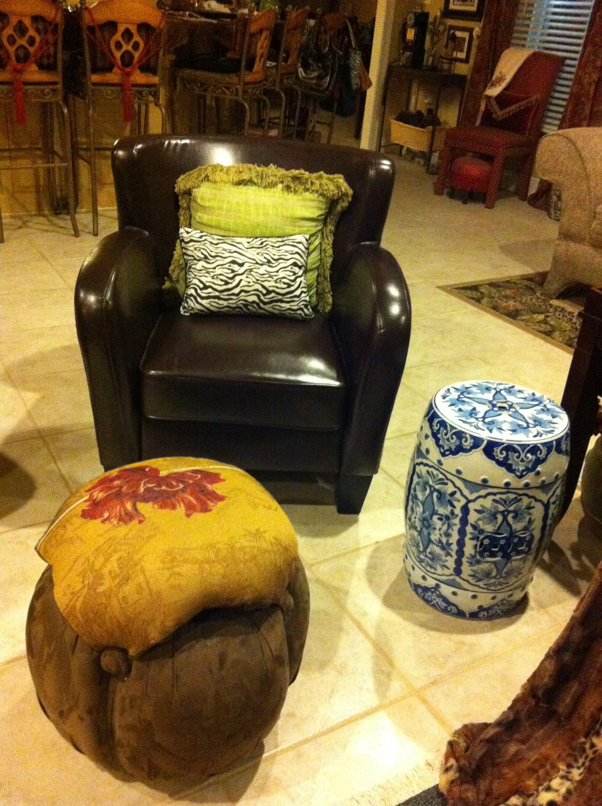 A comfy chair, cool ottoman to prop your feet up. Notice the BLUE and WHITE used as a side table.  (Bring outside inside) You can use a pop of blue and white with most any colors!!