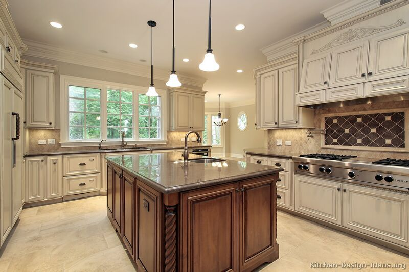 White Kitchen Dark Island light cabinets with dark island, and dark granite counter tops