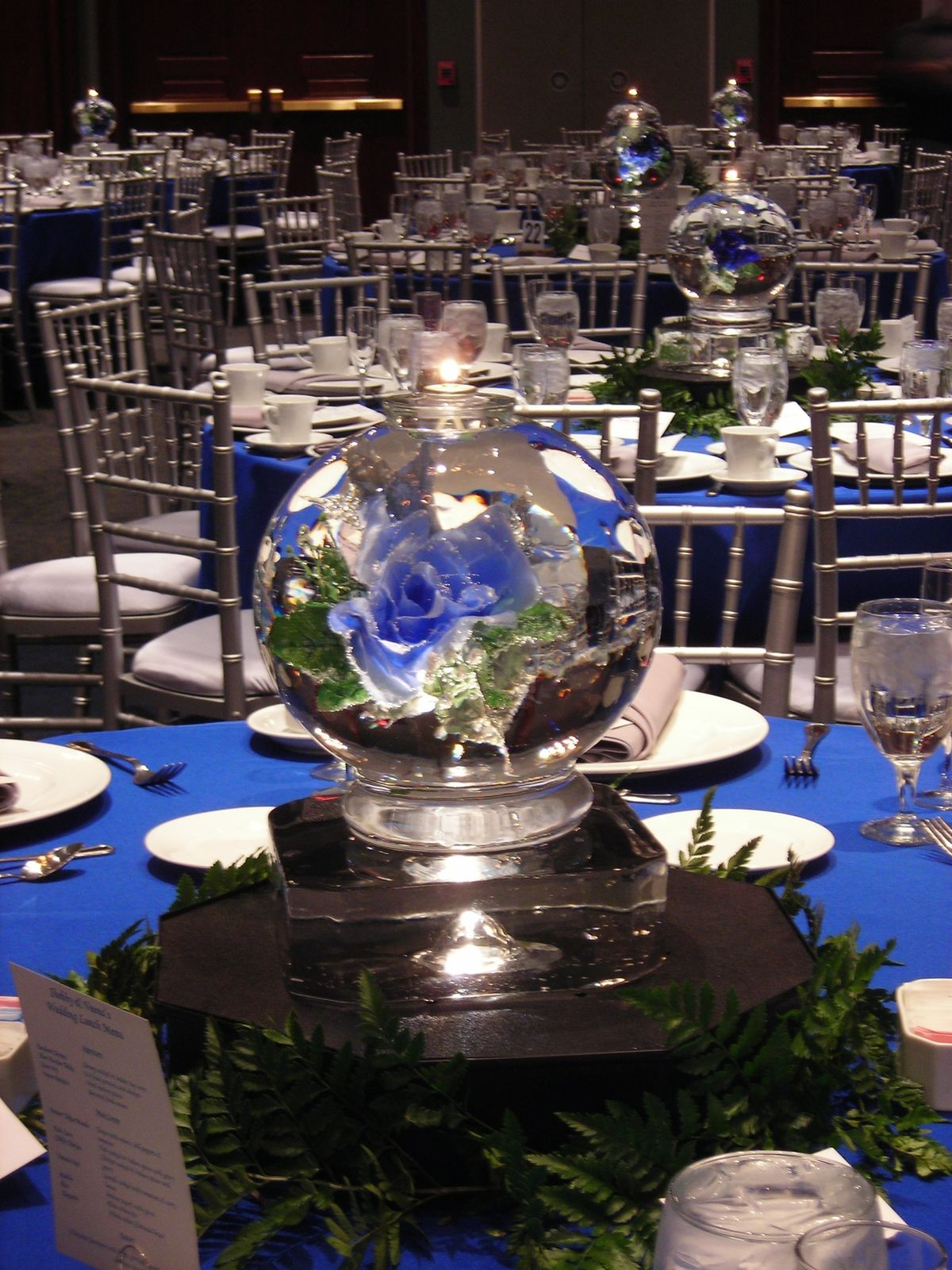 Sphere centerpiece w blue flowers ice sculpture table