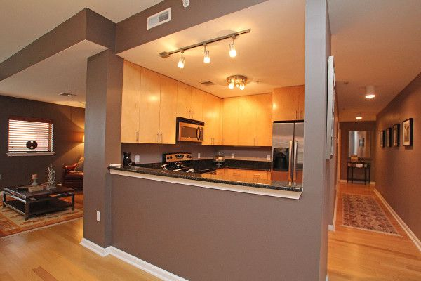L-shaped Open Floor Plan With Central Kitchen