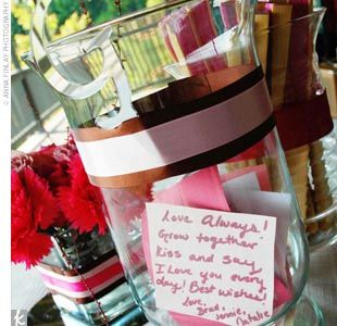 Guests wrote wedding wishes on pieces of card stock in the wedding colors, which were placed in a jar.