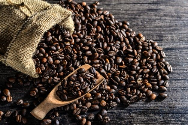 Download Top View Of Wooden Spoon And A Canvas Bag Of Coffee Beans For Free Fair Trade Coffee Coffee Beans Coffee Bean Bags