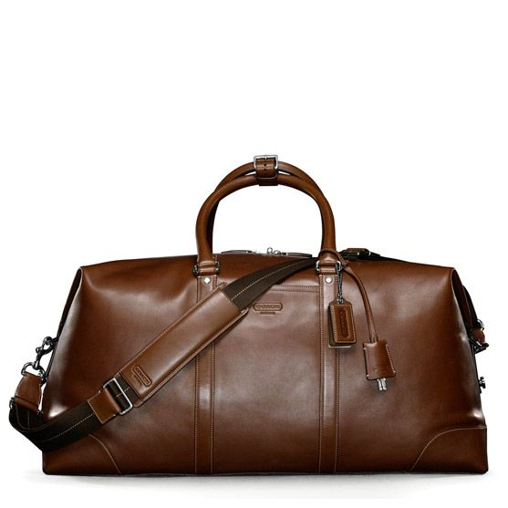 Love the idea of throwing a few items into this Coach travel bag and going away for the weekend.
