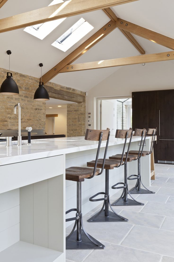 A Gorgeous Bespoke Kitchen With Lovely Features Like The Roof Windows And  Wooden Beams.