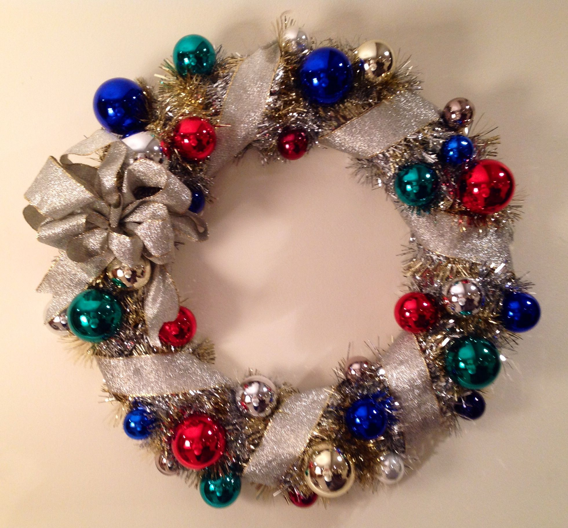 Christmas craft wreath made with glass ornaments. Start