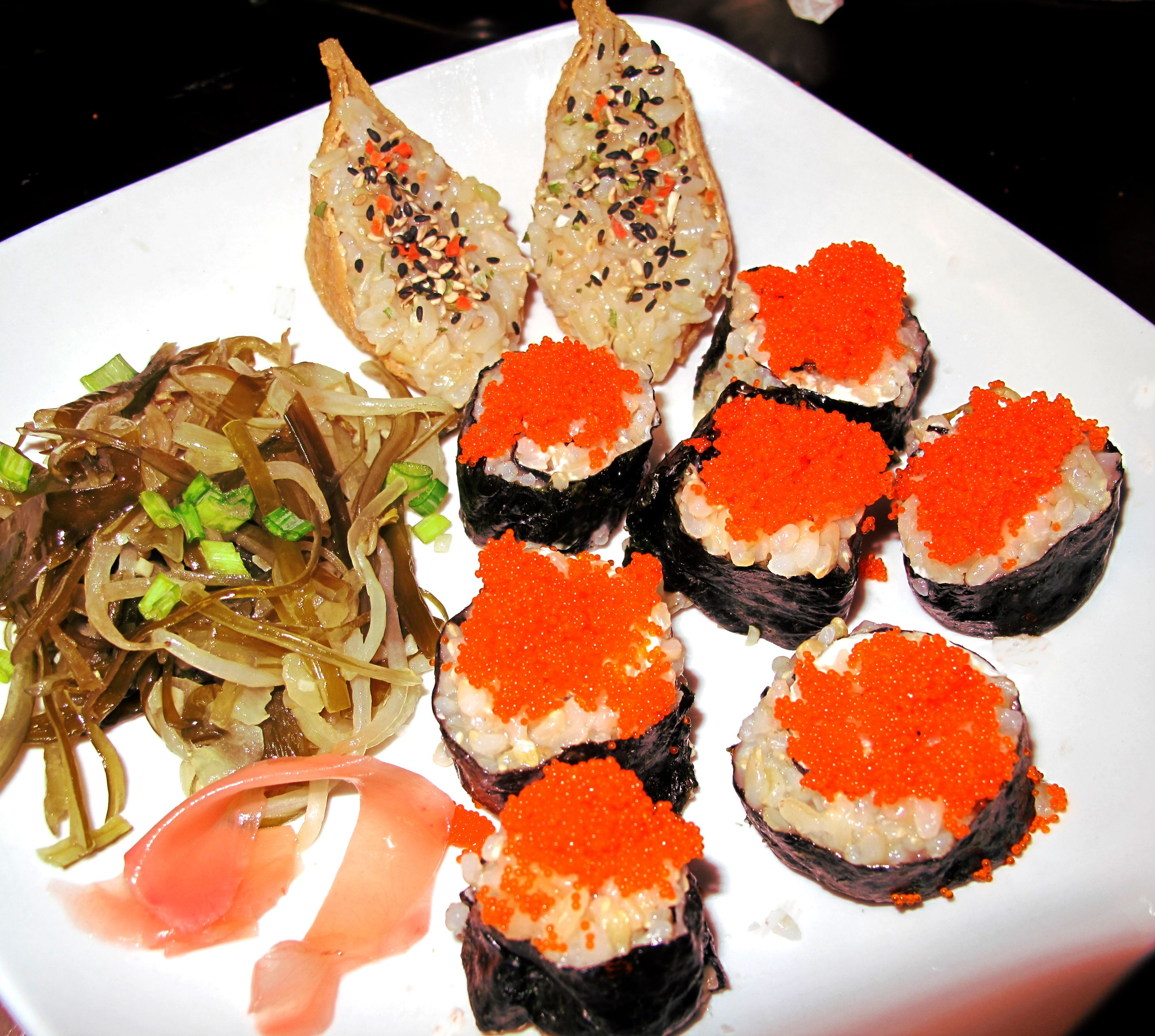 Sushi on a Shoestring Budget...make it at home.  For about $1.00/roll: Nori sheet, Sushi rice (steamed short grain rice with a syrup of rice vinegar and sugar stirred in) and select your fillings or toppings.  This roll has cream cheese and topped with masago.