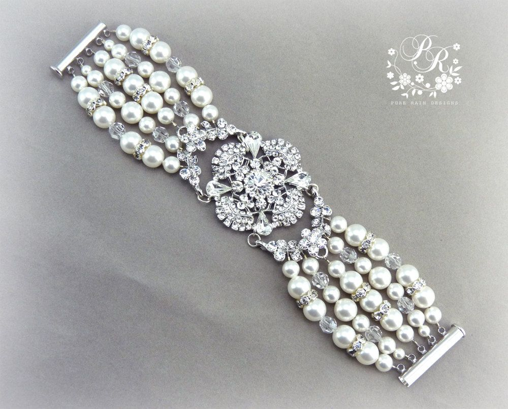 Wedding Bracelet Swarovski Pearls & Swarovski Clear Crystal rhinestone Bridal Bracelet Wedding jewelry Wedding Accessory. $55.00, via Etsy.