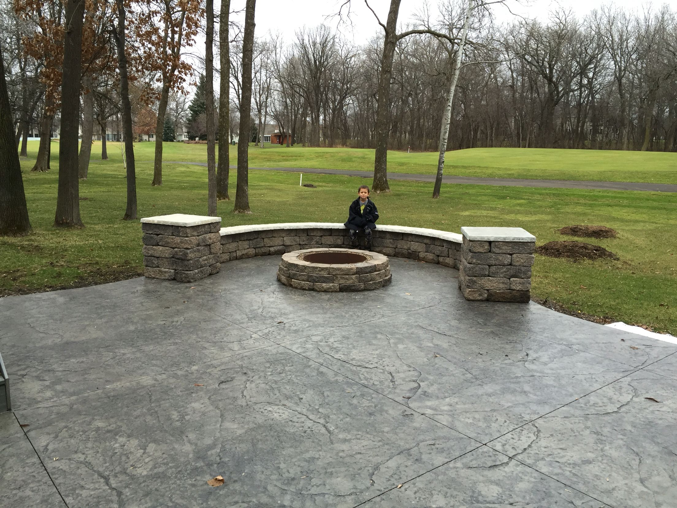 Stamped Concrete Patio With Integrated Seating Wall Pillars And Matching Fire Pit By Sierra Concrete Arts Stamped Concrete Patio Concrete Patio Patio