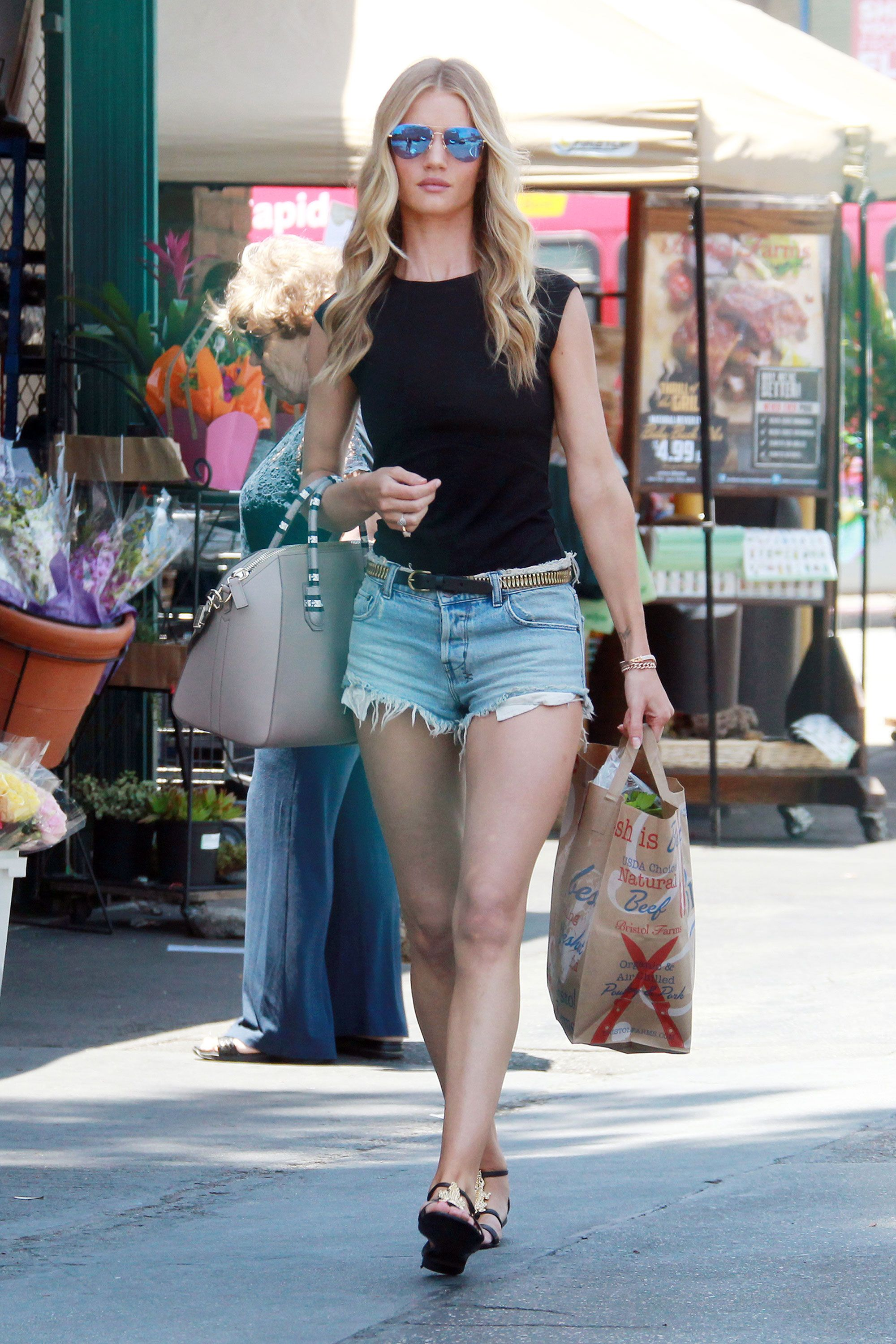 48da40f5fe1 Rosie Huntington-Whiteley keeps it simple while running errands in cutoff  shorts and a tank.