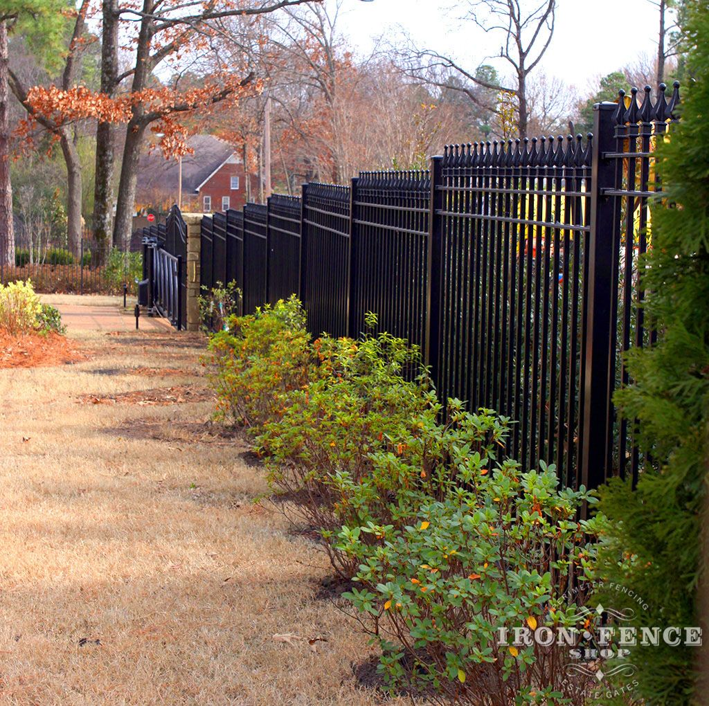 6ft Tall Wrought Iron Fence Stepped To Follow The Slope In A