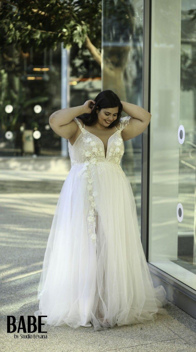 Plus size tulle wedding dress  Unique plus size tulle wedding ball gown with a seductive split D