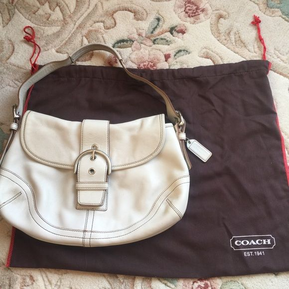 COACH Soho Ivory Leather Medium Hobo Handbag This is a beautiful bag  gently used. Authentic Leather ..This bag is constructed of soft Coach quality leather in ivory with chocolate brown stitching  two interior pockets .. One back slip pocket No marks on interior  Slight interior handle discoloration due to ivory leather color.  12 inches wide by 8 inches high, by 3 inches deep with an adjustable drop from 7-10 inches NO trades please Coach Bags Hobos