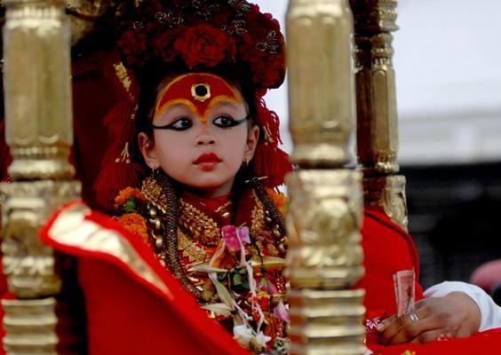 "62d40b3b2 Nepalese traditional dress of Child Goddess. Near the Kathmandu Darbar  Squire lies the temple ""The Kumari Ghar"" of living Goddess (Vestal virgin) ."
