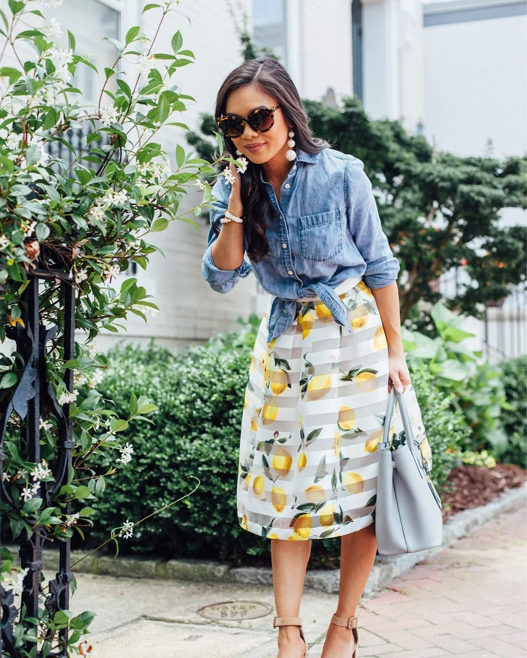 6dfcd4908870 Our new lemon print skirt is perfect for wine tasting or Sunday brunch this  Summer! The bright yellow print and mesh stripes give this midi skirt a  chic yet ...