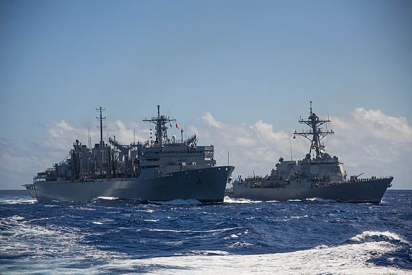 The guided-missile destroyer USS Stockdale (DDG 106) pulls alongside the fast combat support ship USNS Rainier (T-AOE 7) to conduct a replenishment-at-sea.