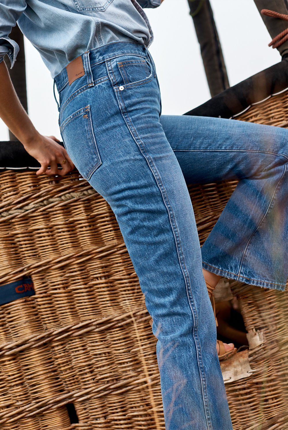 9c6ddb963c7 madewell rigid flare jeans worn with denim western shirt.