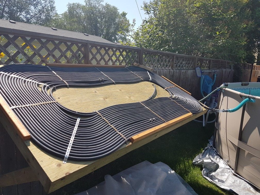 Solar Pool Heater 350 Feet Of 1 2 Inch Tubing Pumped With A 1 6 Horse Sump Pump Solar Pool Heater Diy Solar Pool Heater Diy Pool Heater