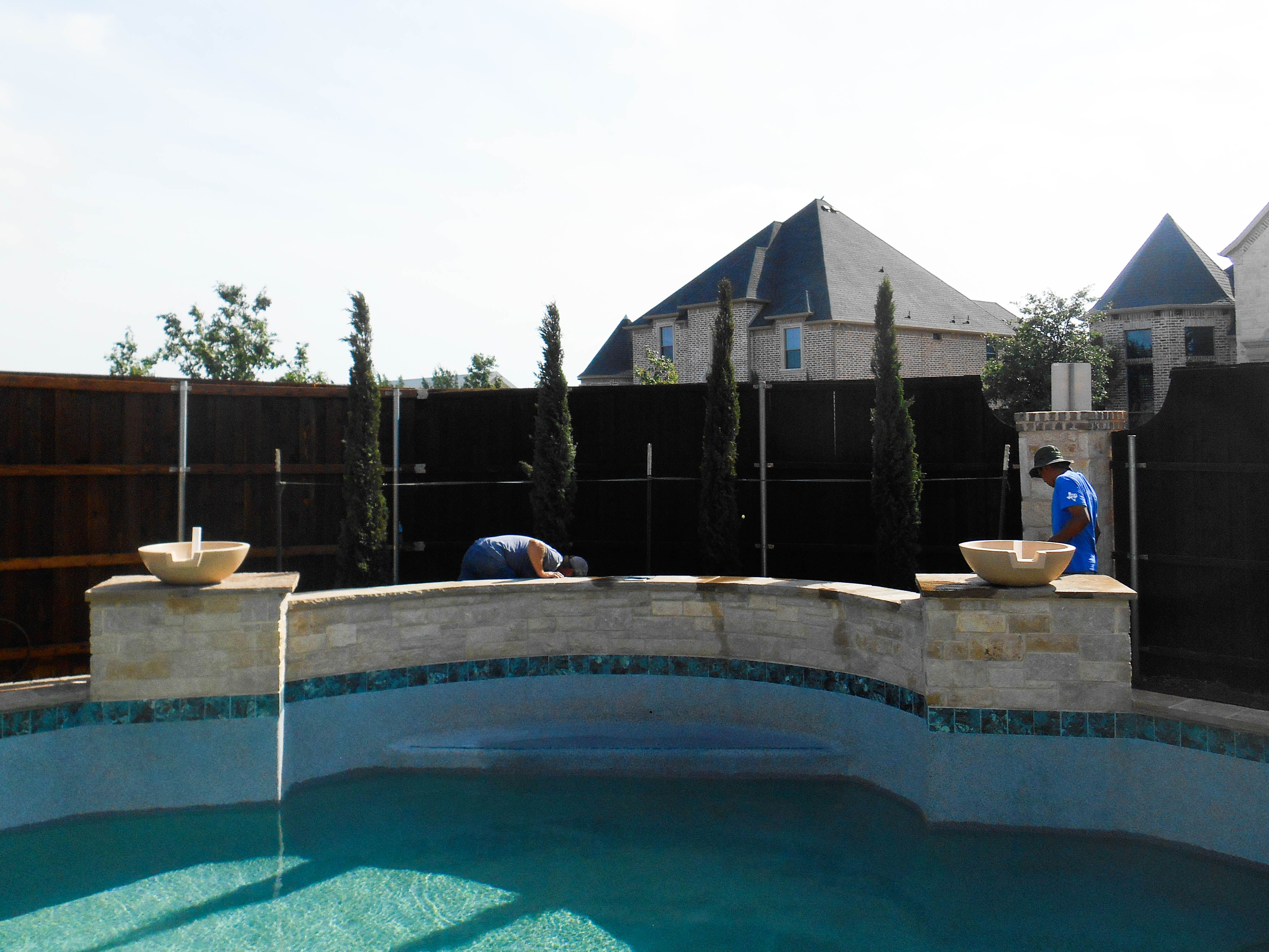A Row Of Italian Cypress To Accent This Stone Wall Around