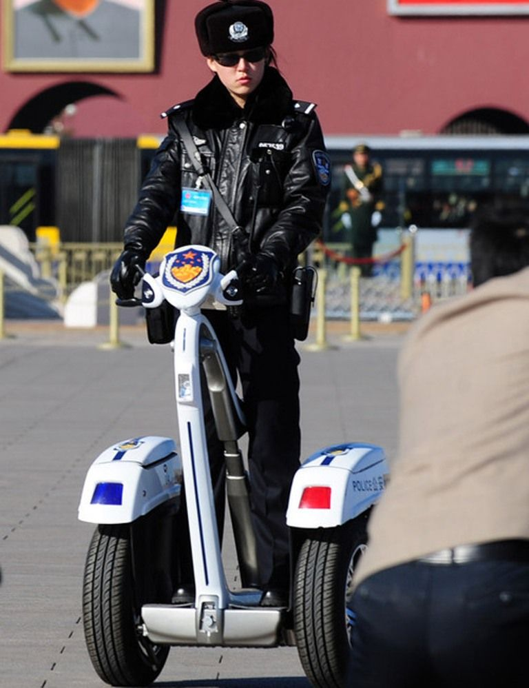 A Chinese female police officer watches the performances