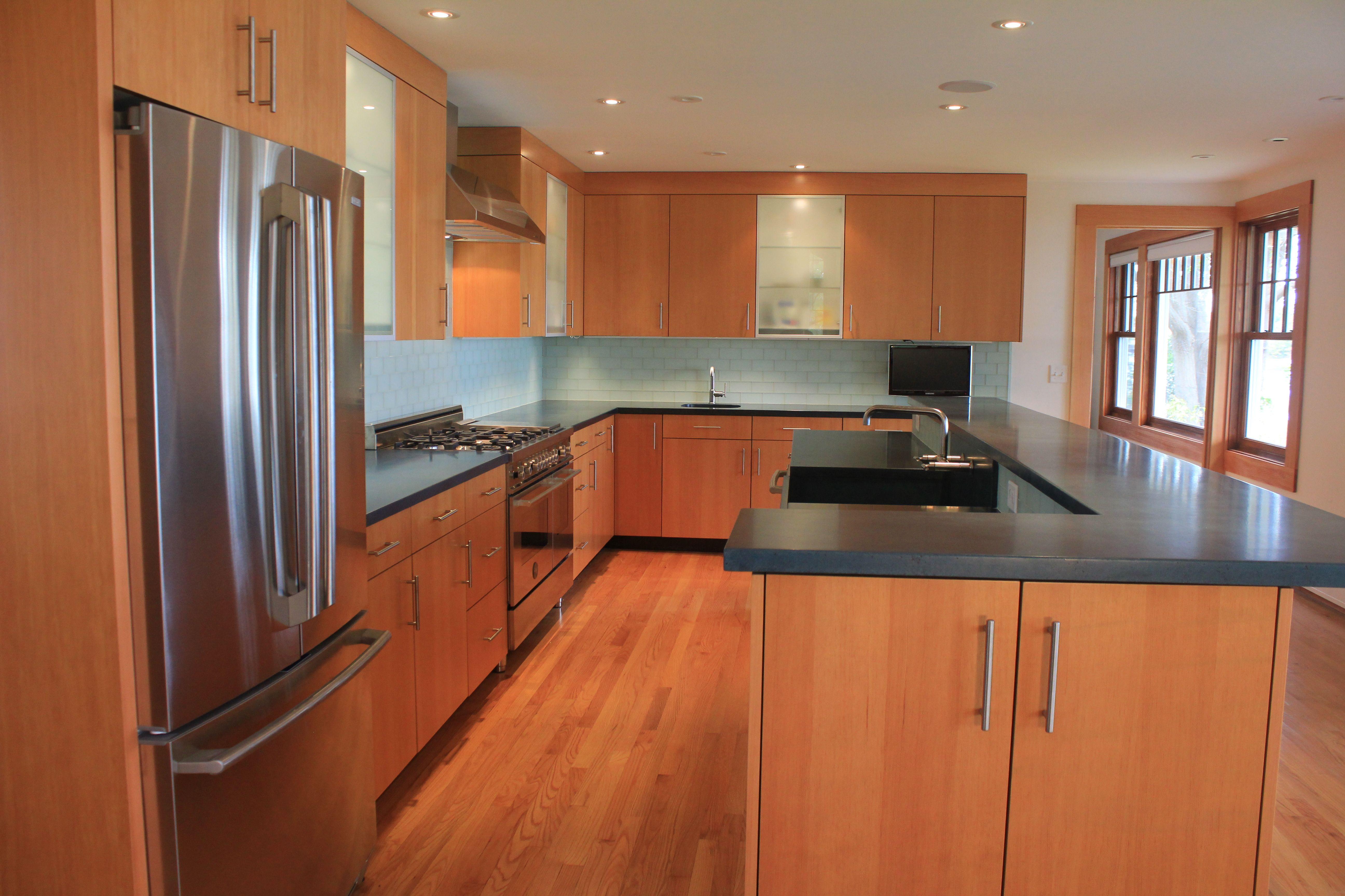 Modern Kitchen With Douglas Fir Veneer Concrete Counter Tops And Glass Subway Tile Backspla Kitchen Countertops Kitchen Island Countertop Kitchen Inspirations