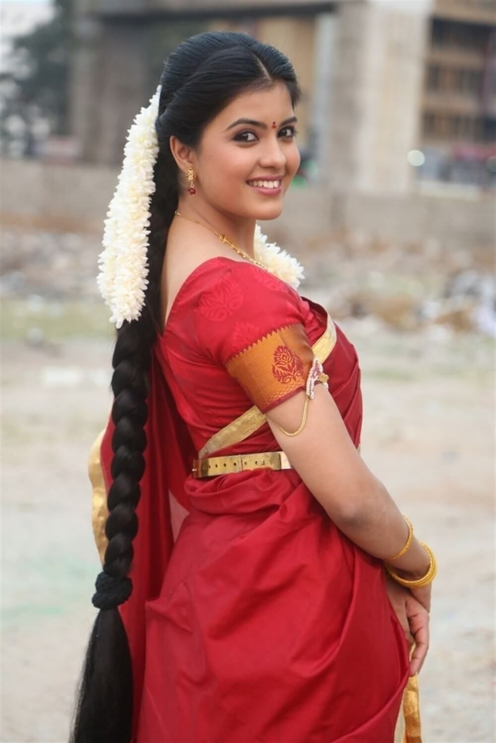 south indian woman with long braid and fresh jasmines in her