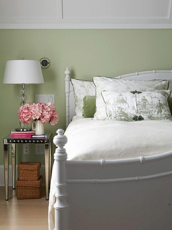 Restful Color Scheme    ale fern-green walls in this guest room provide a serene backdrop for the inviting faux-bamboo bed in bright white. Mirrored side tables add modern glamour, and green toile bedding brings in traditional style. Because of its restful and neutral quality, the light green makes the small touches of vivid pink -- the billowing hydrangeas and stack of books -- pop.