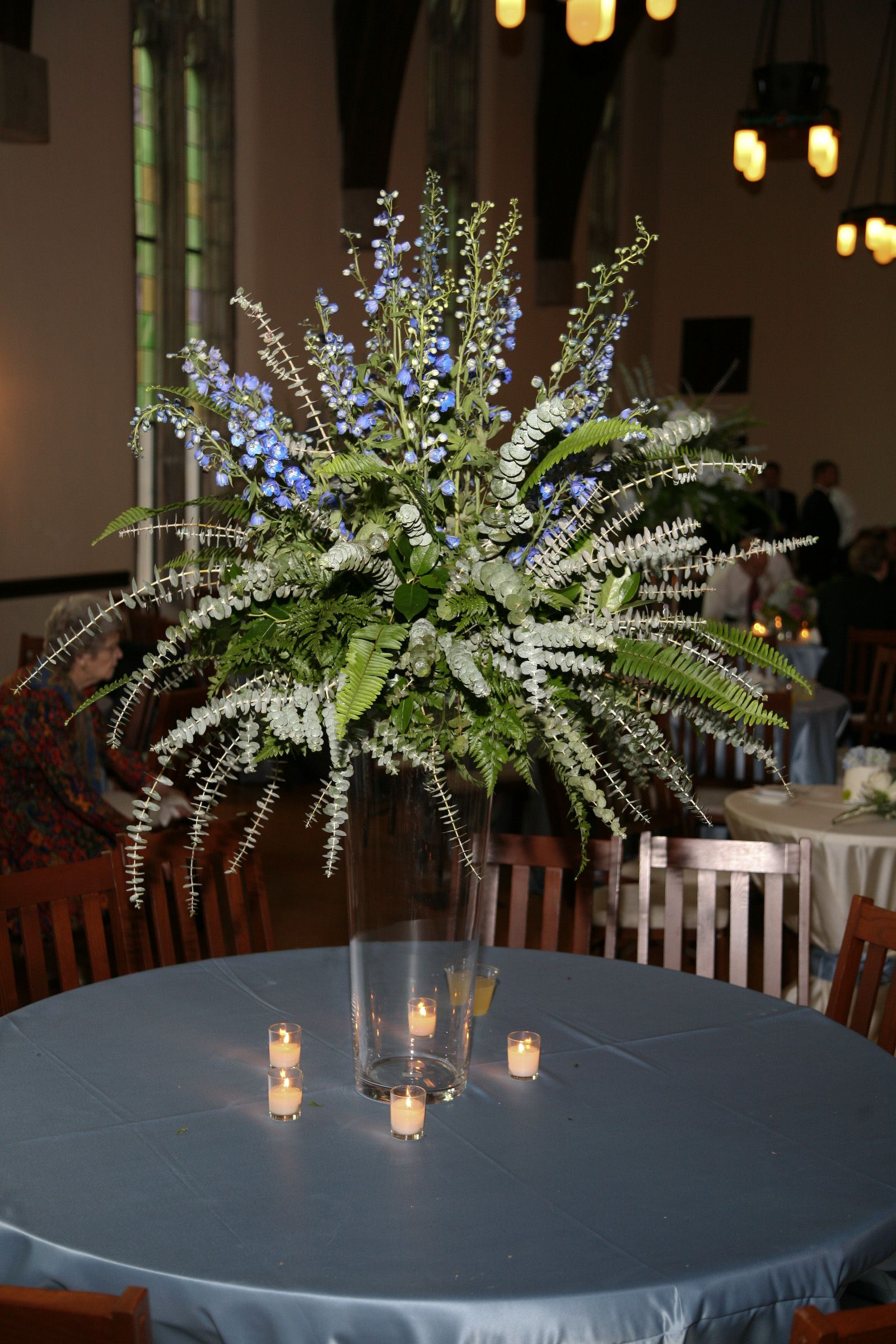 Tall Centerpiece With Lots Of Greenery Including Eucalyptus, Salal Leaves,