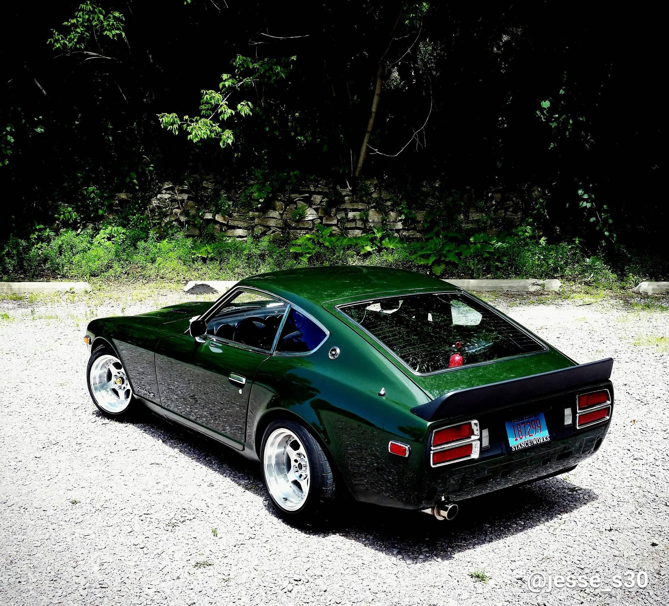 My Driveway built 280z in factory green Japanese sports
