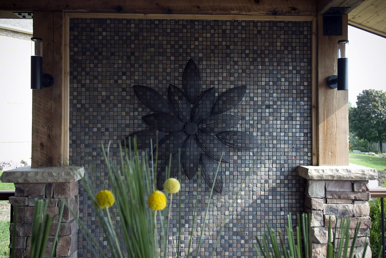 This solid privacy barrier includes a metal art feature for Metal privacy screens for decks