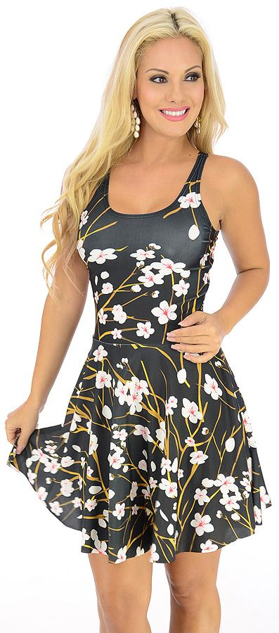 Tripping-$20.80-Have them tripping over themselves for a chance to talk to you in this delectable dress. The satiny fabric features a floral inspired print that adds a feminine touch. The blunt cut hem of the slightly flared skirt creates a smoothing finish in this racerback fashion.