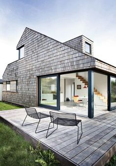 I love the idea of turning a classic gable 90 deg and then breaking up the lines. Beautiful  Tiny Minimalist house - NordicDesign