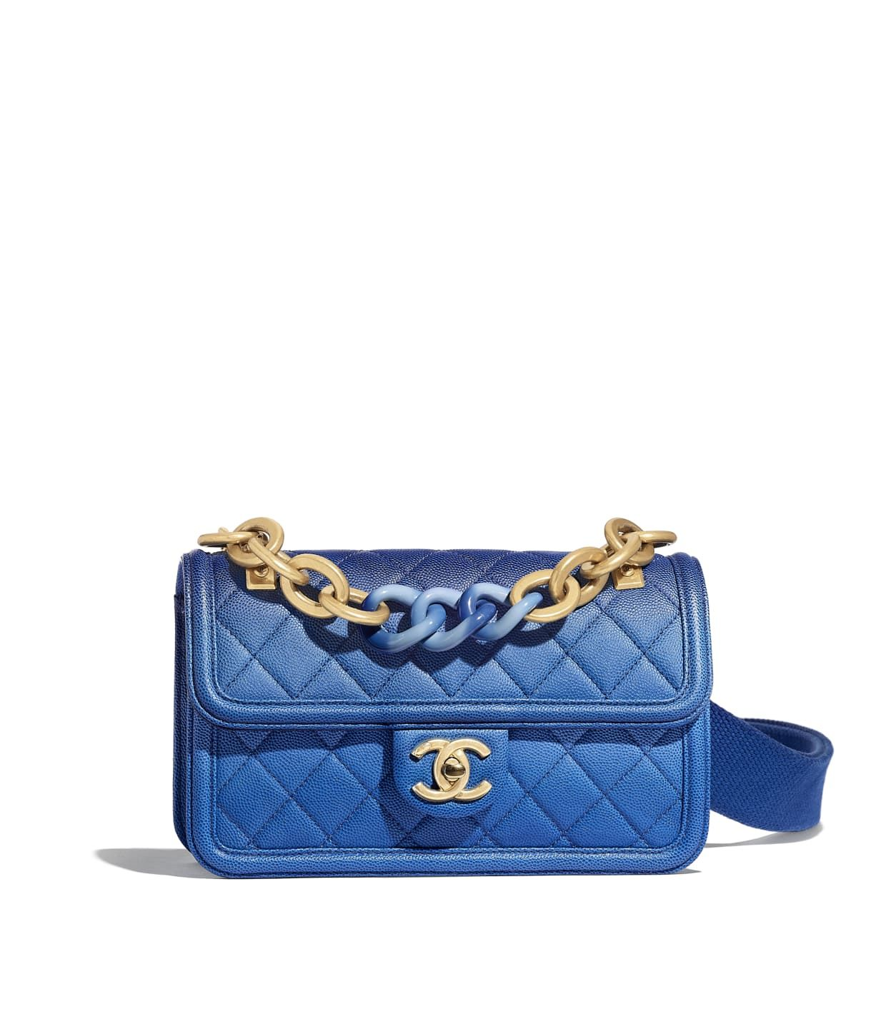 70fe4c1e292526 Discover the CHANEL Grained Calfskin, Resin & Gold-Tone Metal Blue Flap Bag,  and explore the artistry and craftsmanship of the House of CHANEL.