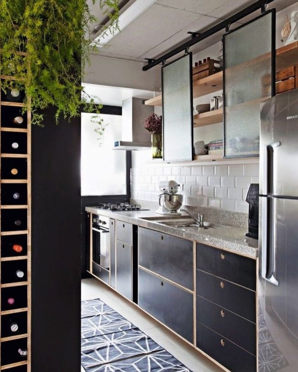 This kitchen keeps it light with opaque glass sliding cabinet doors. #smallkitchendesigns