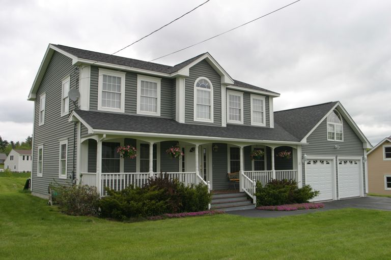 Gray Colonial With Two Car Garage And Covered Porch Colonial Style Homes Colonial House Home Construction