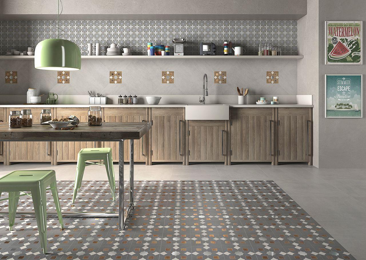 Cocina decorada con piezas que mezclan materiales como el acero con ...