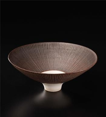 Footed bowl, Porcelain, manganese and white glazes, incised radiating sgraffito design. 7 in. (17.8 cm.) diameter, c.1964