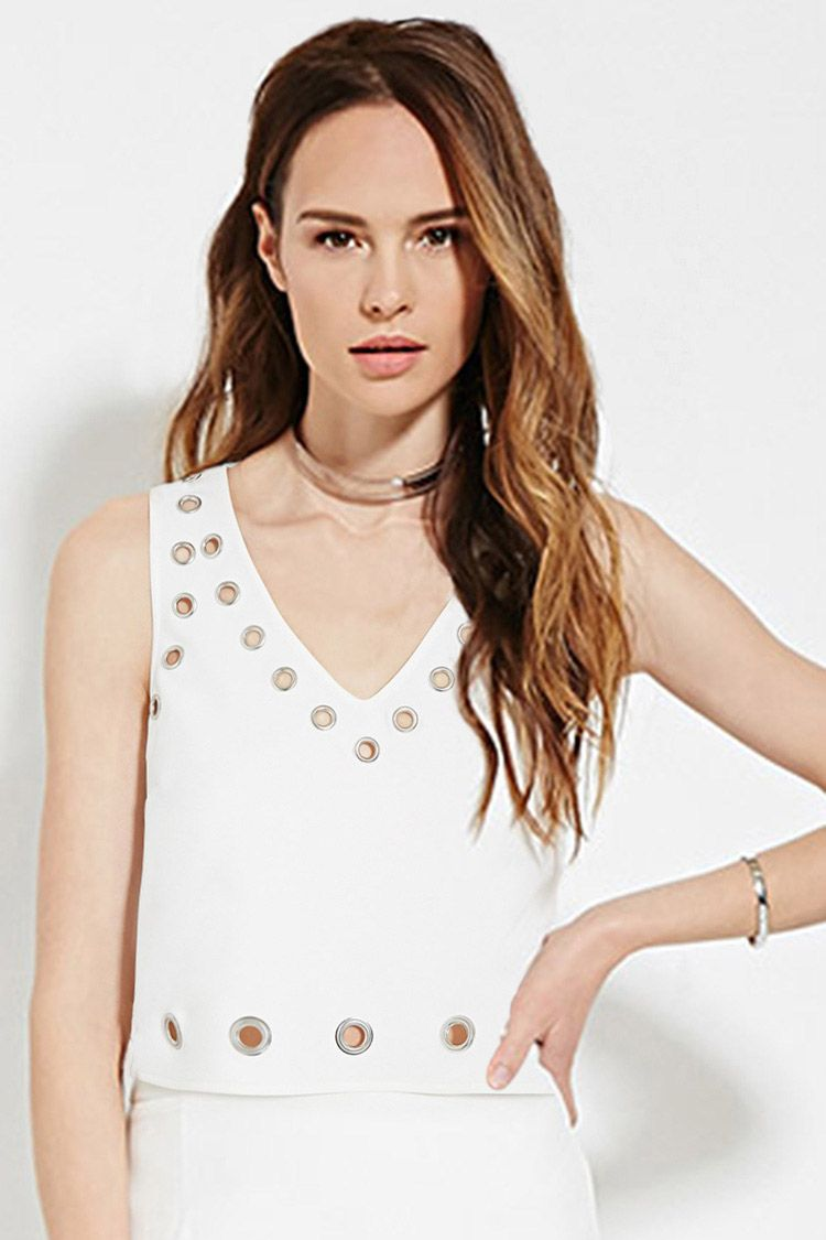 Forever 21 Contemporary - This boxy woven top features a sleeveless cut, a V-neckline, and grommets adorning the trim throughout. Matching skirt available.