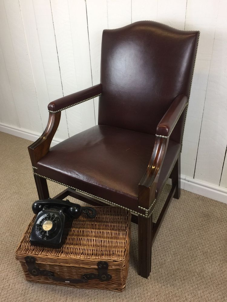 Deep red brown leather office board room chair with