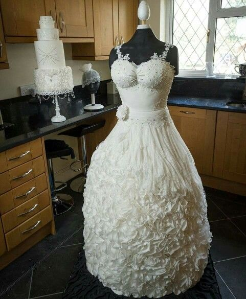 Wedding Cake Idea that is thinking outside the box!  A dress made entirely of cake!