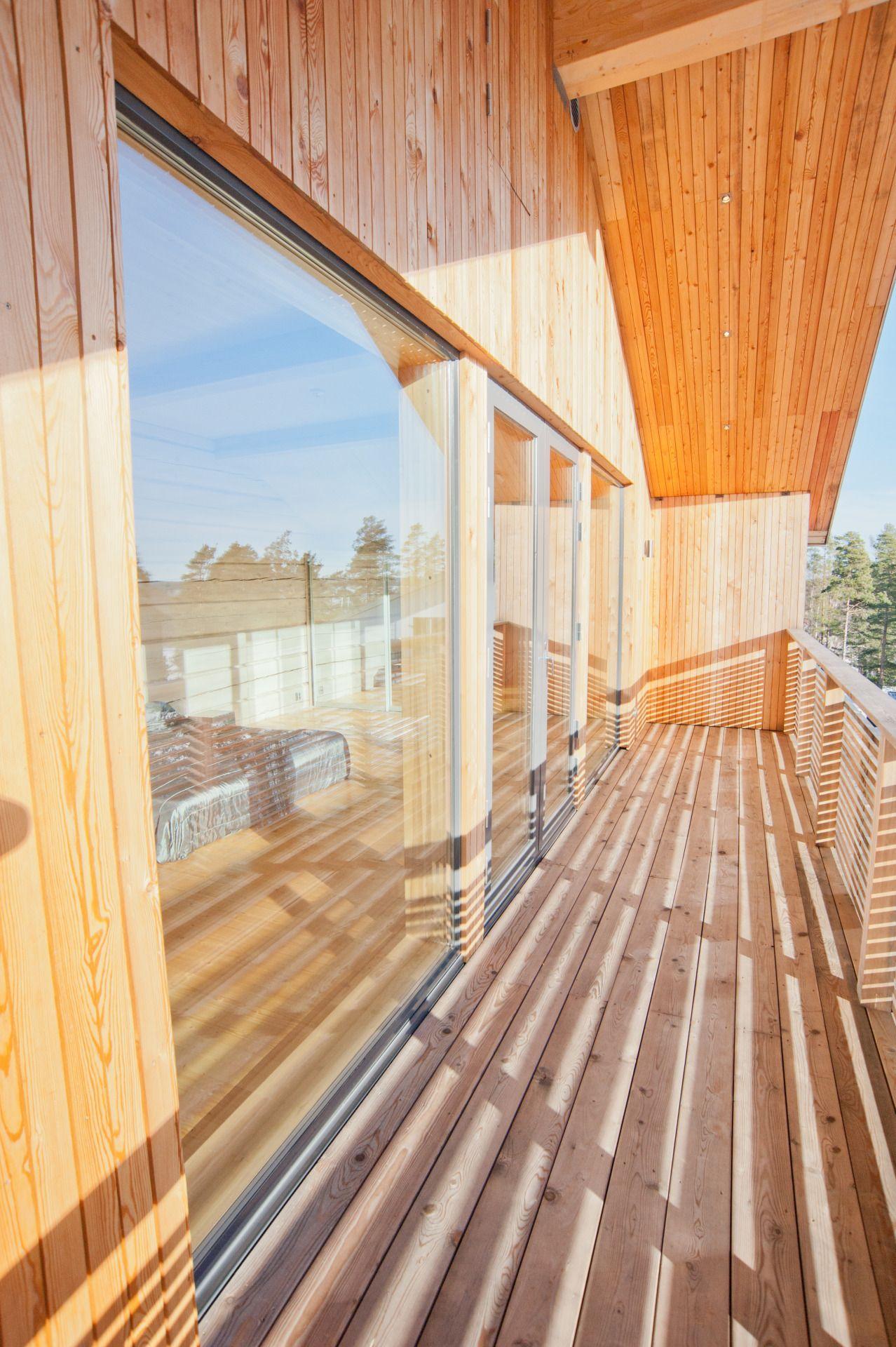 Modern log house, master bedroom balcony.
