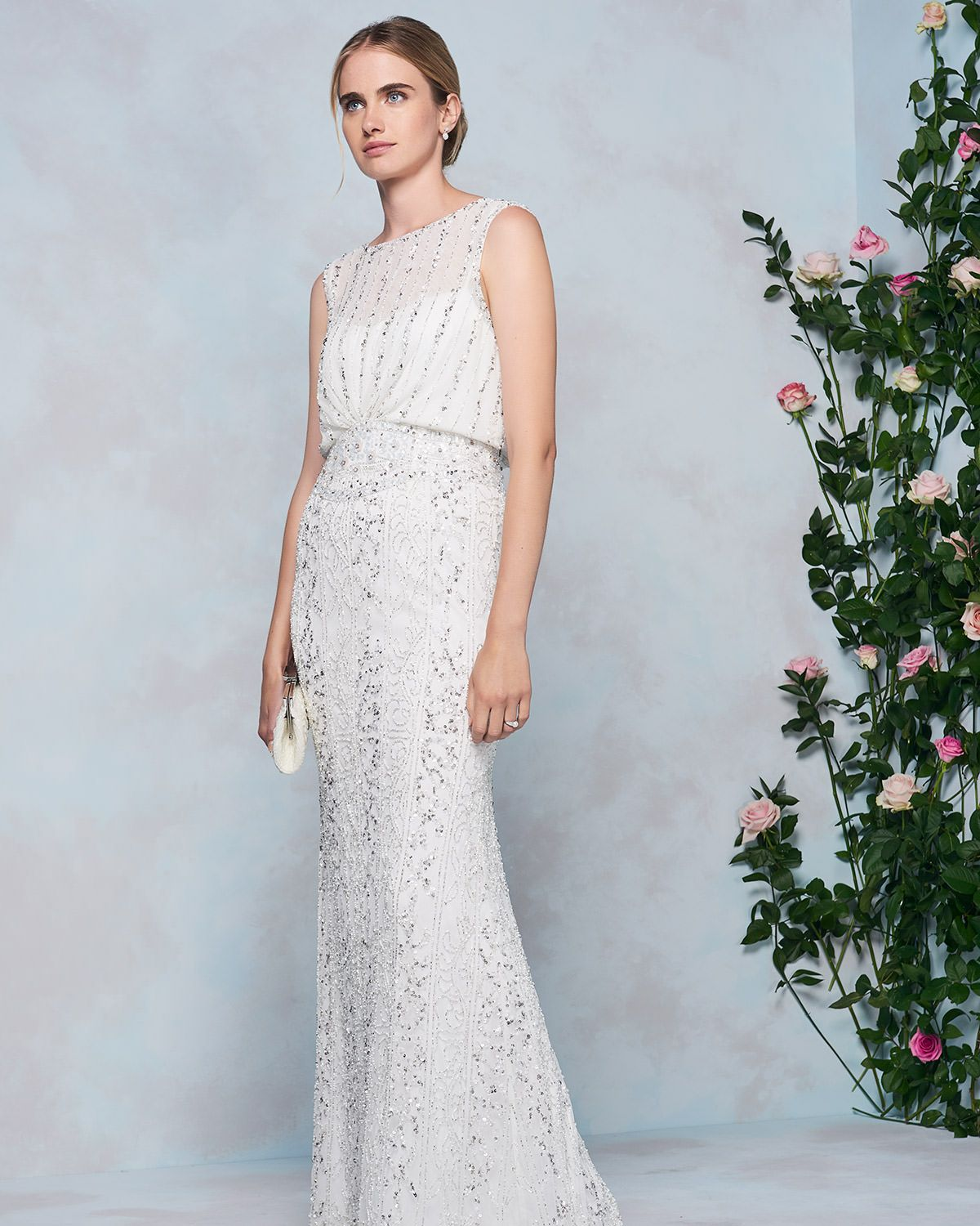 A 1920s inspired wedding dress heavily embellished with shimmering ...