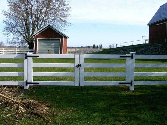 White vinyl farm fence with double drive gate vinyl fence