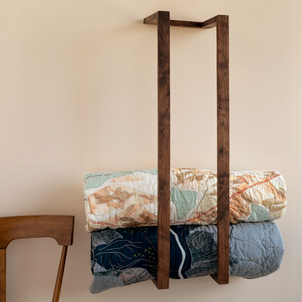 this modern wooden wall rack can store