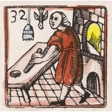 Medieval woodcut--bread baker << Well, a cook at any rate. That is an oven on the right though.