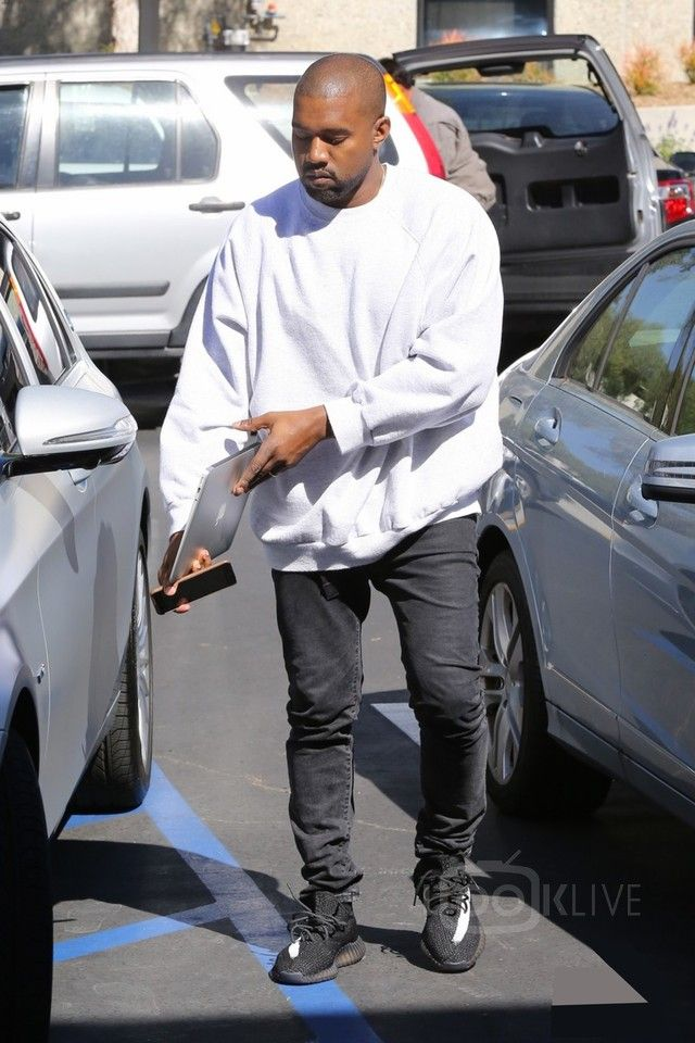 4946cefa81a Kanye West - Arriving at the studio wearing his new sneakers on in ...
