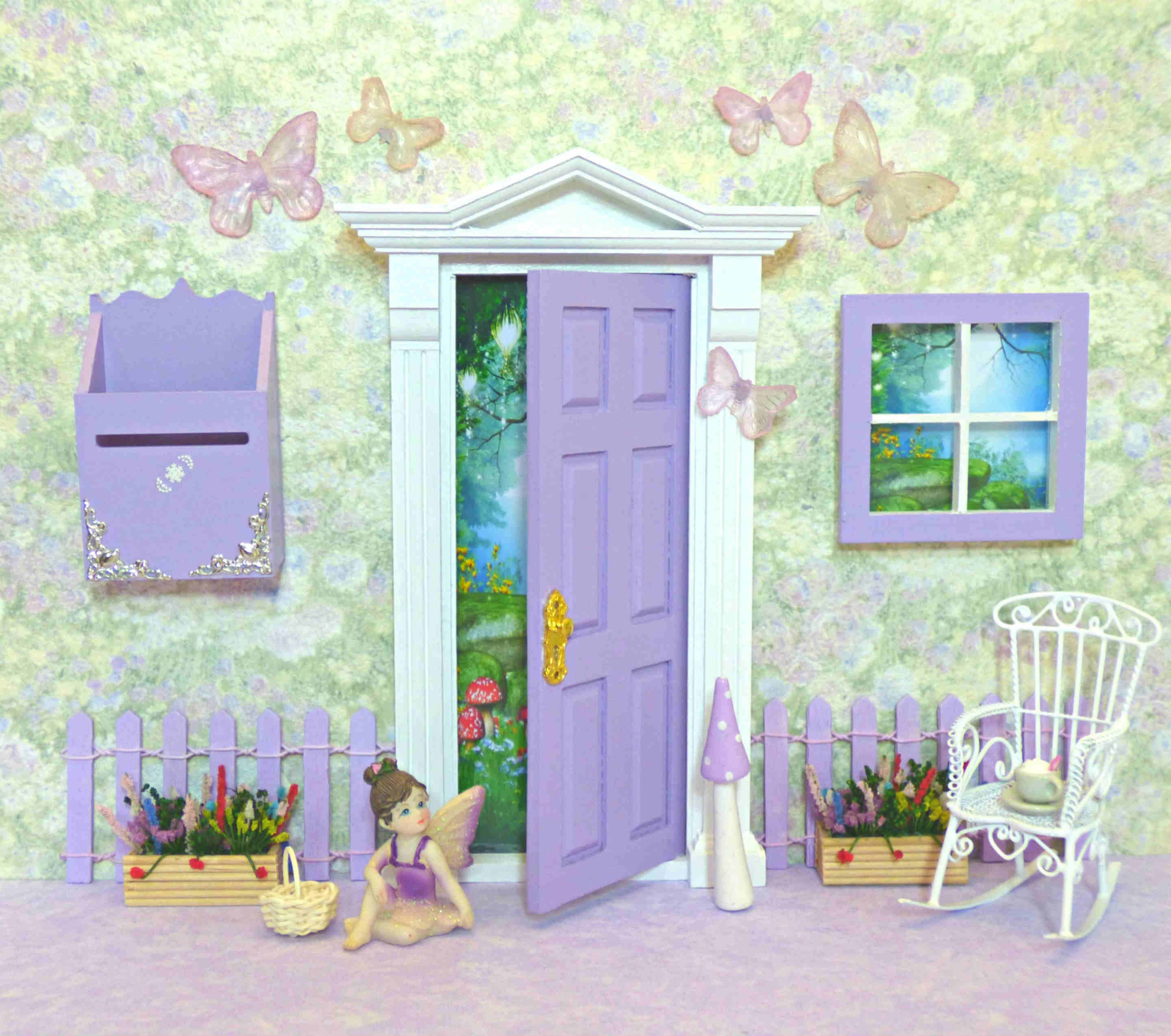 Purple opening fairy door with accessories proudly for The little fairy door company