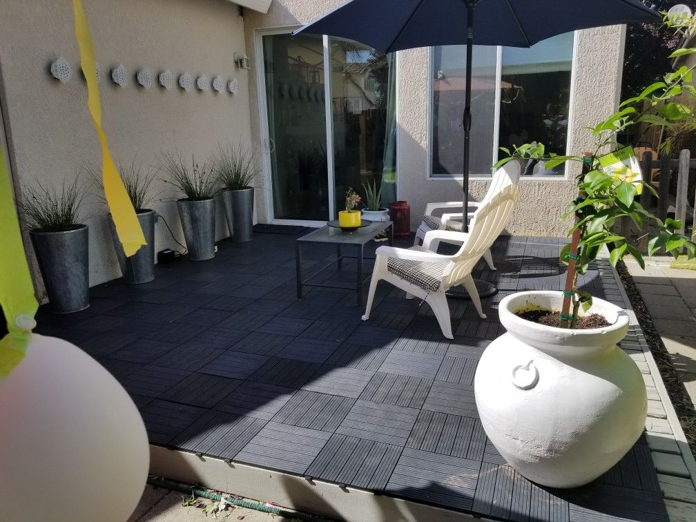 Love Costco composite deck tiles. Black deck. Modern