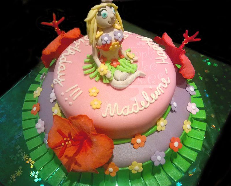 Hawaii Themed Birthday Cake With Hibiscus Flowers And Hula Girl
