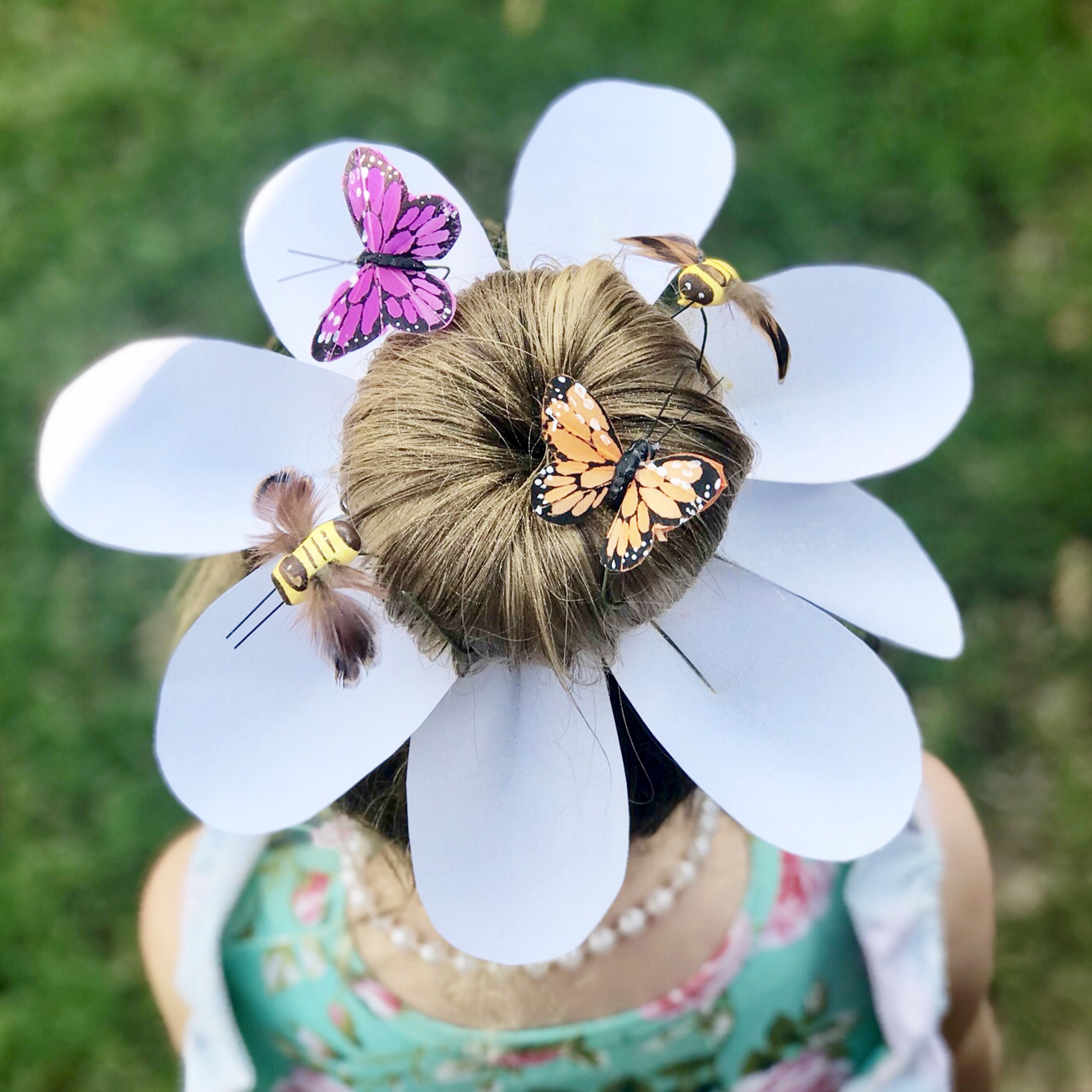 Crazy hair day ideas: flower, spring. Petals were cut from white card stock, hot glued to bobby pins, and fastened to hair. Butterfly and bumblebee floral stems were purchased from Hobby Lobby. #kidhair